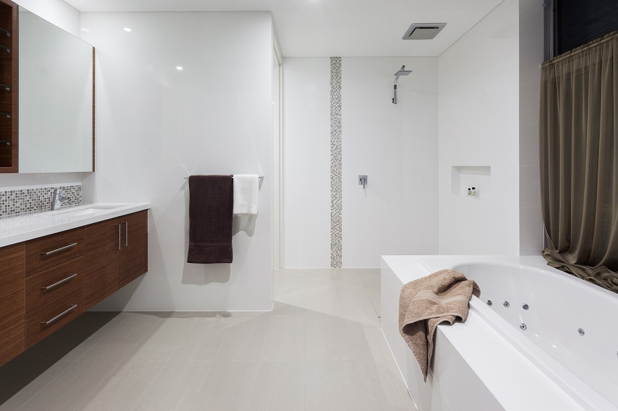 Spacious modern bathroom with separate tub and shower.