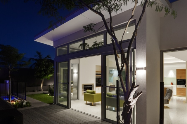 Night time view looking into this luxurious modern home in Dianella.
