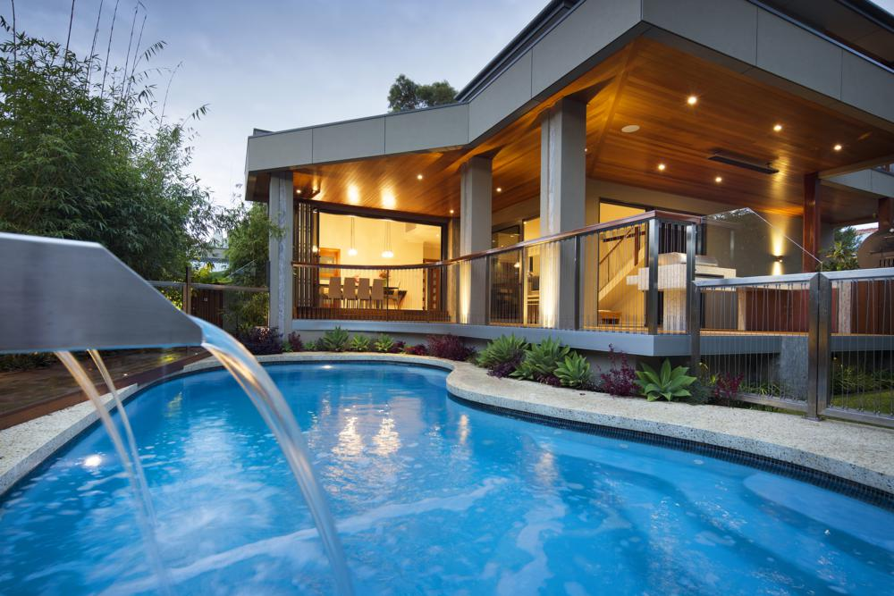 view across swimming pool to outdoor living area.