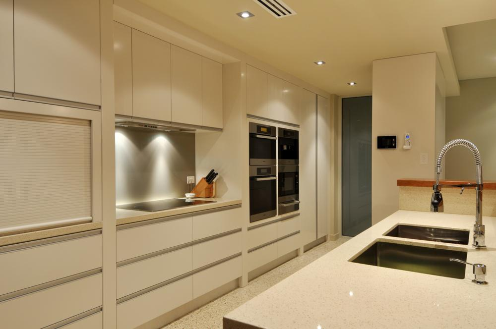 plenty of storage and preparation space in this modern kitchen by Sol Construction.