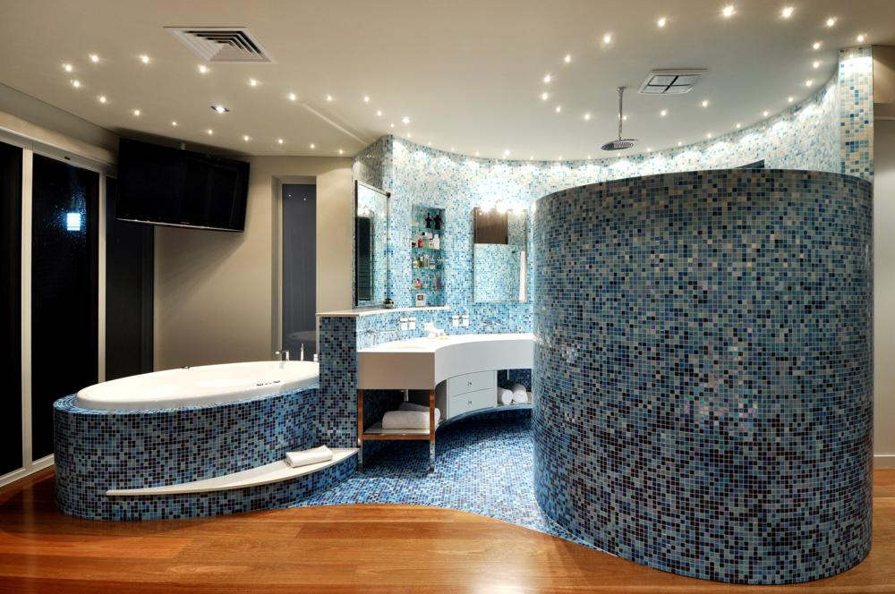amazing blue tiled custom bathroom in boutique hillarys home.