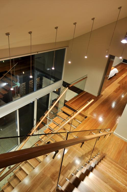 timber stairs with glass balustrades and timber handrails feature prominently.
