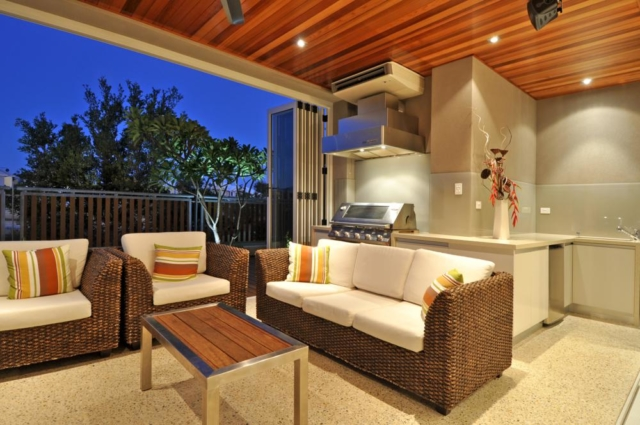 entertaining area with sofas and bbq.