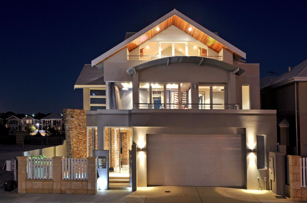 luxury hillarys home front view at night.