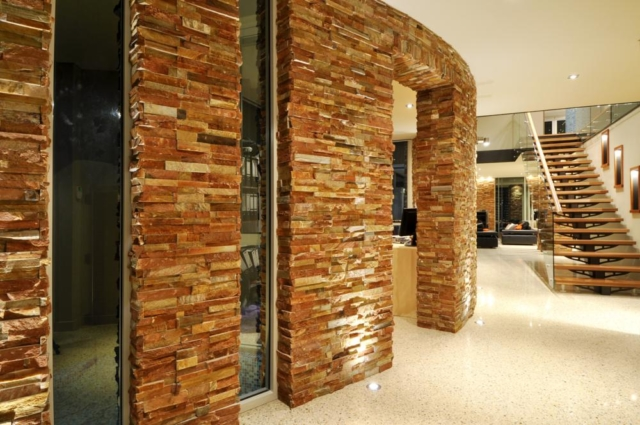 view of stacked flat stone feature wall in luxury hillarys home.