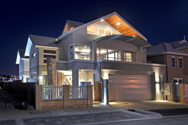 custom built home in hillarys photographed at night.