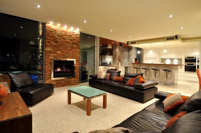 luxurious open living area with fireplace.