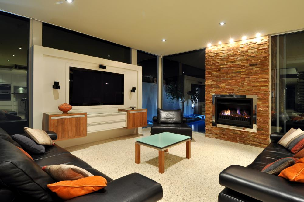 this hillary home boasts a large living area with built in tv theatre setting.