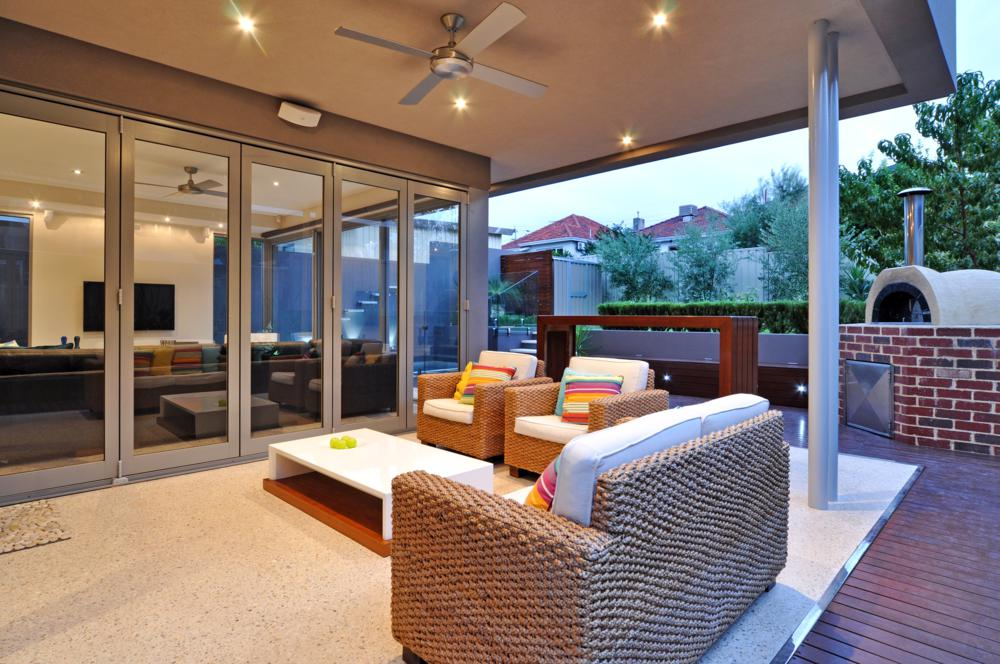 perfect outdoor entertaining area with sofas, bbq and pizza oven.