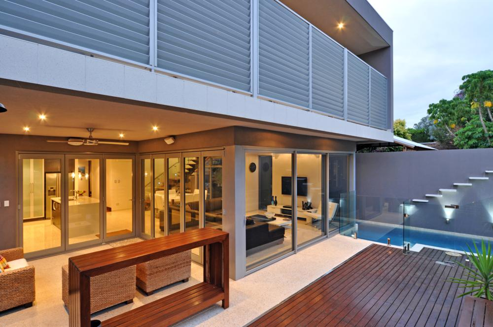 view of the deck to small lap pool in backyard of renovated mt hawthorn home.