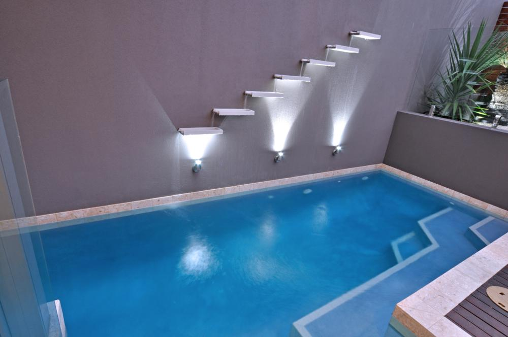 outdoor pool with contempory lighting design.
