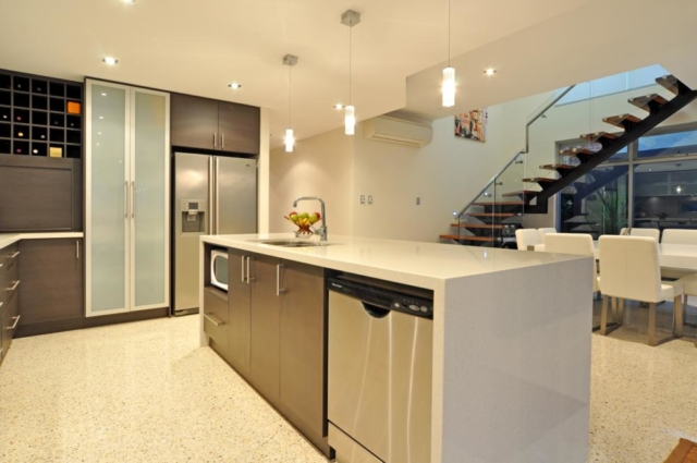 view from kitchen to dining area and staircase.